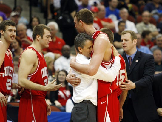 Cornell Big Red center Jeff Foote hugs head coach Steve