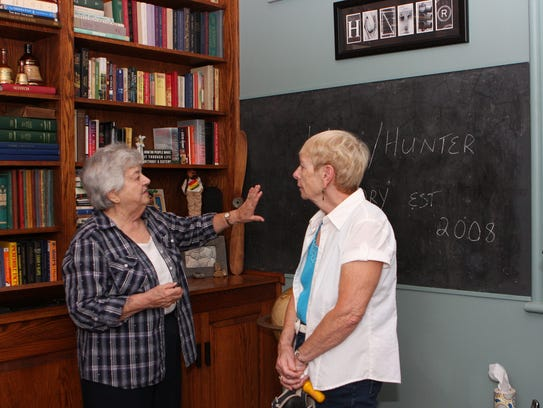 Docent Betty Zann talks about the blackboards in the
