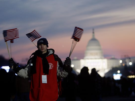 A Boy Scout is ready to hand out flags on the National