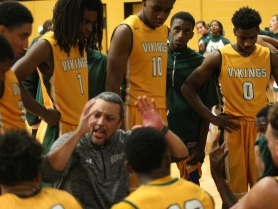 Northwest coach Vincent Turner instructs his team during