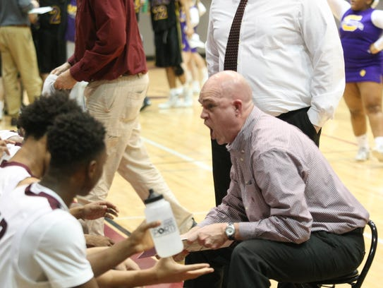 West Creek coach Russell Malone screams at his team