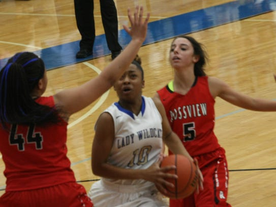 Rossview's Kayla Gilmore (44) and Holly Sellers (5)