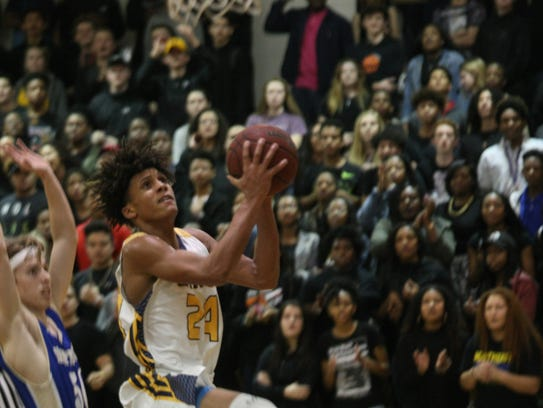 Northeast's Alec Kegler (24) drives to the basket to