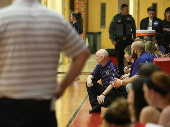 Clarksville coach Brian Rush (kneeling) led the Lady