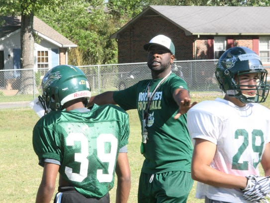Northwest coach Vernon Wright directs his players where