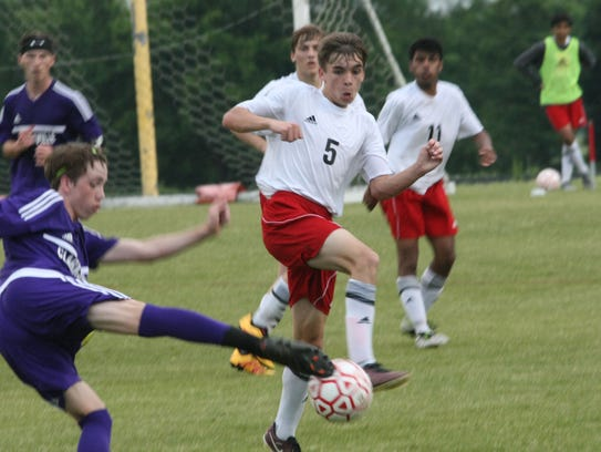Rossview's Cameron Carroll (5) tries to avoid the kick