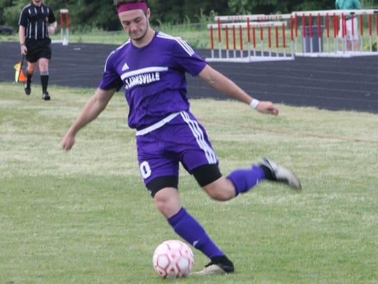 Clarksville's David Jones kicks the ball toward a teammate