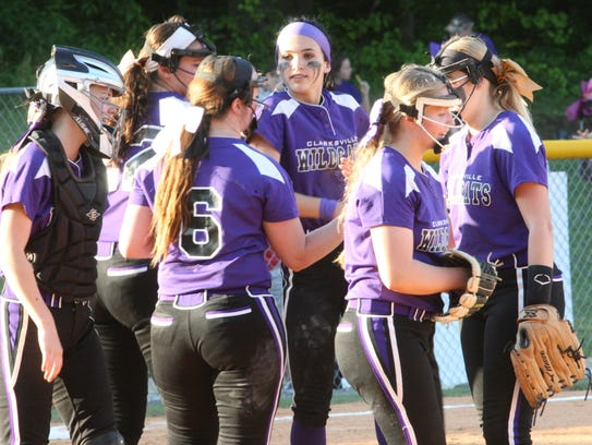Clarksville High's infield gathers in the pitcher's