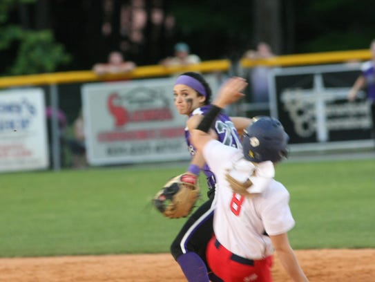Clarksville High's Sarah McCellan tries to avoid the