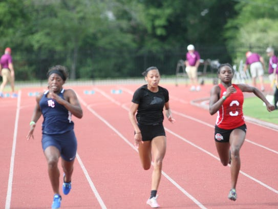 West Creek's Asha Jennings (center) competes in the