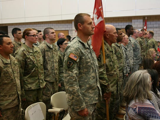 Members of the 111th Engineer Battalion stand in formation