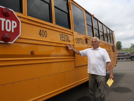 Bob Breed poses next to a Vestal Central School District