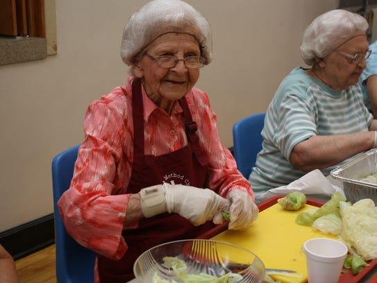 Helen Gaspar, 93, of Binghamton, rolls halupki at St.