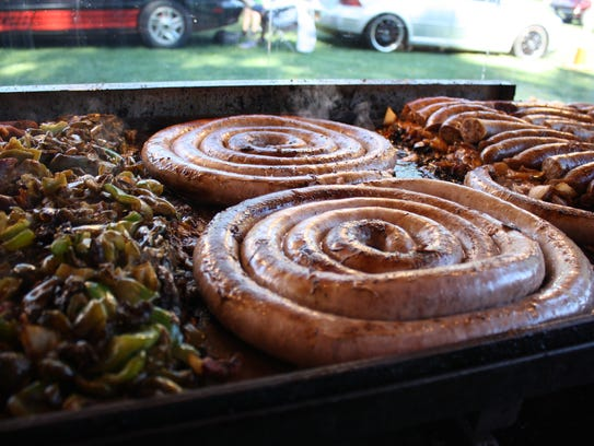 Sausage is prepared by Santillo's  at the Spiedie Fest