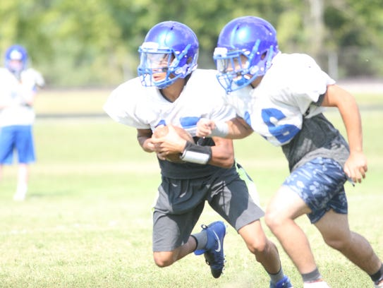 Fort Campbell quarterback Abdel Howard keeps the ball