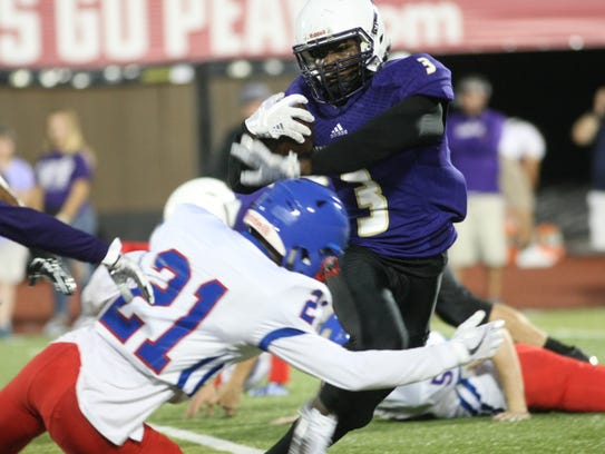 Clarksville High's Josh Watch tries to avoid the tackle