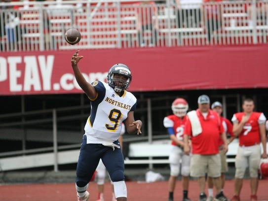 Northeast quarterback Heath Williams throws the ball