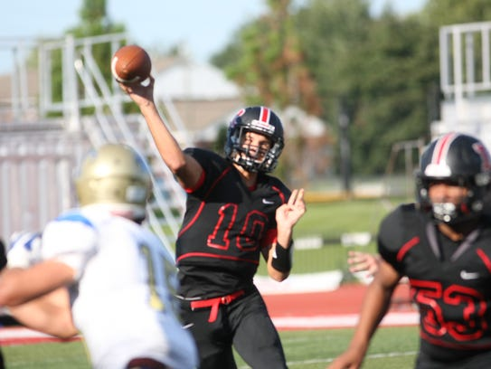 Rossview quarterback Nick Harbor (10) throws the ball