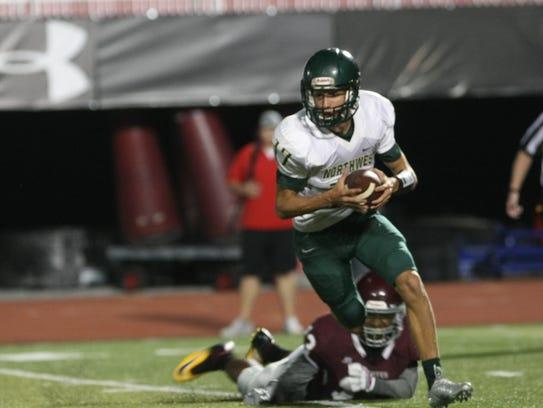 Northwest quarterback Hunter Silverstrim tries to avoid