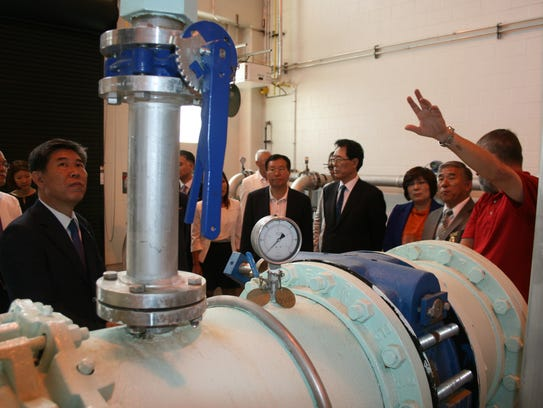 The Gunpo delegation views equipment at the Clarksville