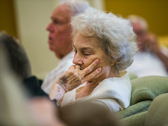 Lorna Rewis mourns during the funeral service for her
