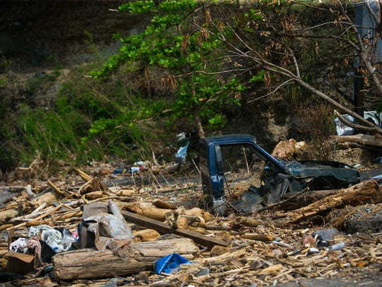 Destroyed vehicles lay in rubble in Colihaut, Dominica,