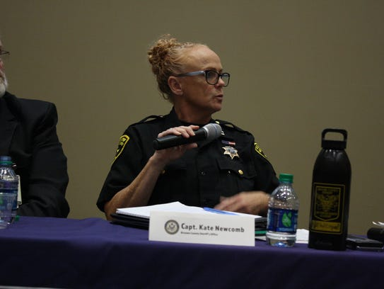 Kate Newcomb speaks during the Opioid and Heroin Community