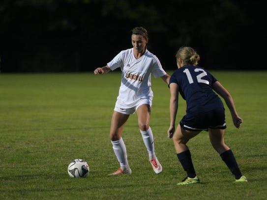 Clarksville High's Kristen Gasaway looks for room to