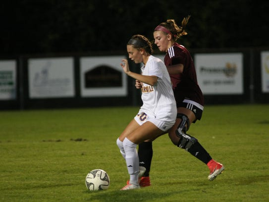 Clarksville's Kristen Gasaway tries to block out a Collierville player during the first half Saturday night.