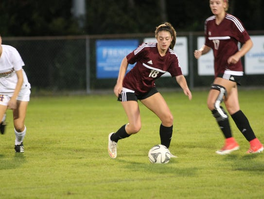 Collierville's Kate Johnson (18) looks to turn up field against Clarksville.