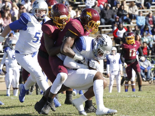Pearl River defenders wrap up the Co-Lin ball carrier