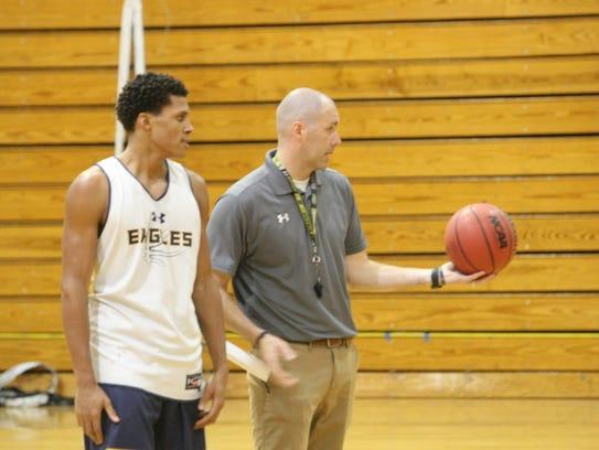 Northeast High basketball coach John Stigall (right)