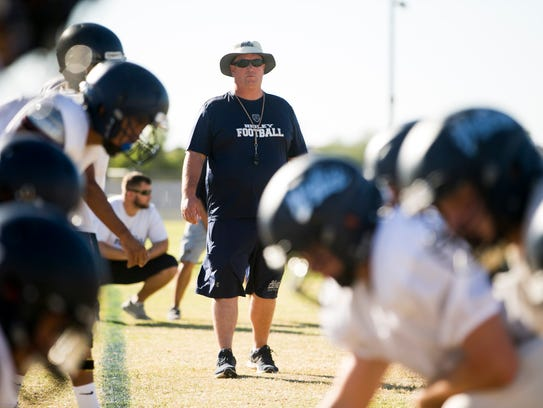 Higley High School head football coach Eddy Zubey leads