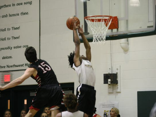 A Northwest player attempts a follow up after a missed