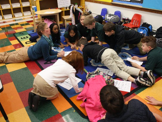 Heather Shaffer leads students at St. James School's