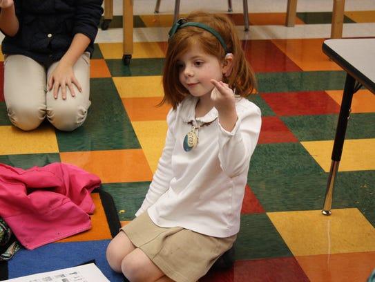 Ann Redmore, 6, participates in St. James School's