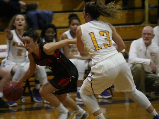 Rossview's Holly Sellers tries to drive past Clarksville