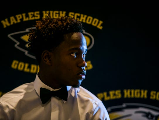 Sammy Faustin signs with Michigan at Naples High School