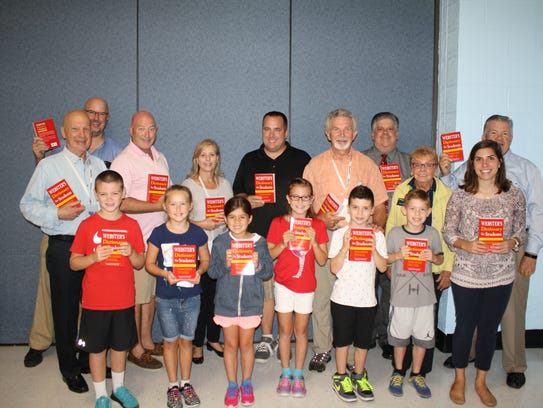 The Denville Rotary Club poses with third graders from