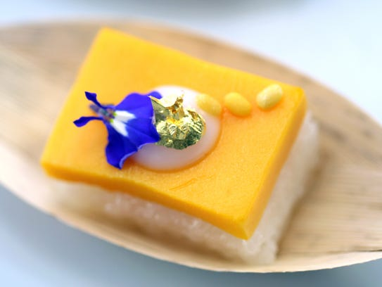 This Thai mango and sticky rice dessert is topped with