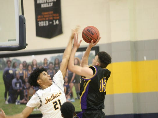 Clarksville High's Devyn Bender (15) goes up for a