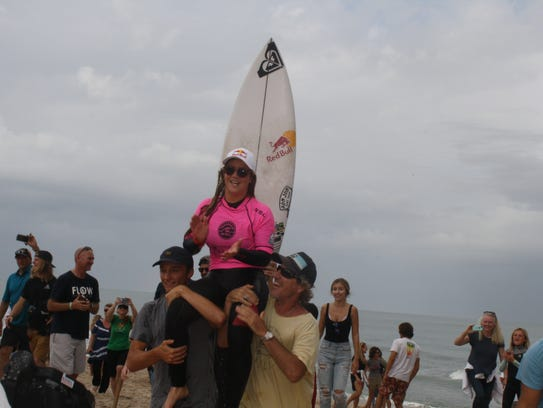 Caroline Marks being carried to the beach after her