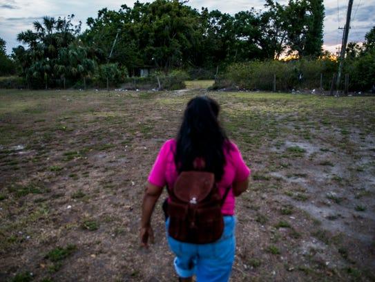 "Jesusita ""Susanna"" Rodriquez walks to her camp at the"