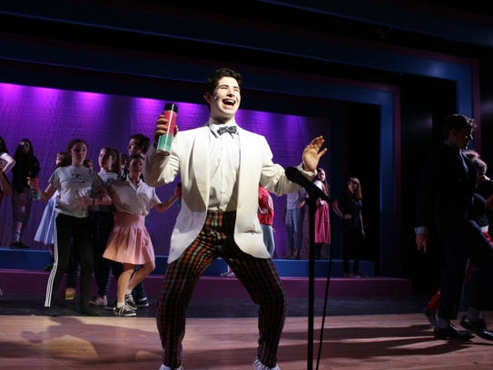 """Imri Leshed leads the cast of """"Hairspray"""" while rehearsing"""