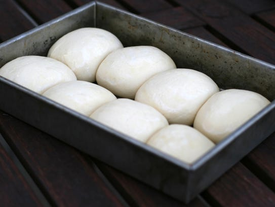 Dough balls rise one to two hours before they're ready