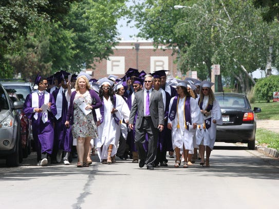 Students and faculty walk to Fremont Ross High School's
