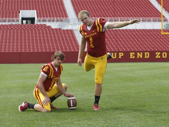 Iowa State punter Colin Downing holds the ball for