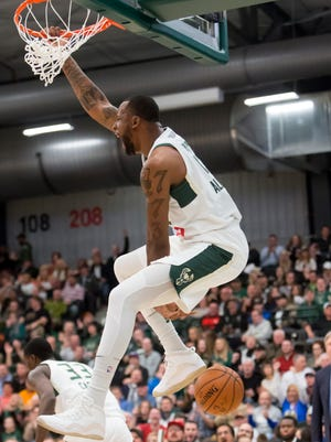 Cliff Alexander of the Wisconsin Herd reacts after a dunk shot Friday during the home opener at the Menominee Nation Arena December 1, 2017.