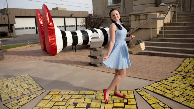 "Pam Kravetz's fanciful designs for The Carnegie's ""lightly staged"" version of ""The Wizard of Oz"" first appeared when a Yellow Brick Road and two enormous legs popped up in front the Covington arts center in early December. The show, which also features the Kentucky Symphony Orchestra, runs January 21-31. Seen here is Caroline Chisholm, who plays the role of Dorothy."