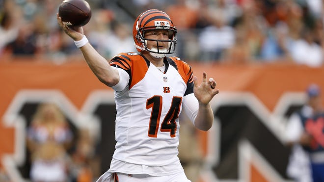 Cincinnati Bengals quarterback Andy Dalton (14) passes the ball in the first quarter against the New York Jets at Paul Brown Stadium.